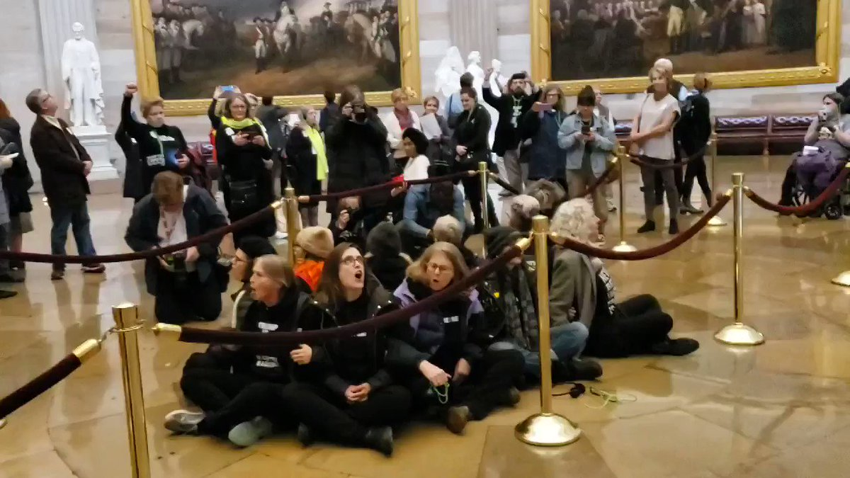 Chants of 'Honor your oath!' reverberate off the Capitol Rotunda as protesters stage sit-in