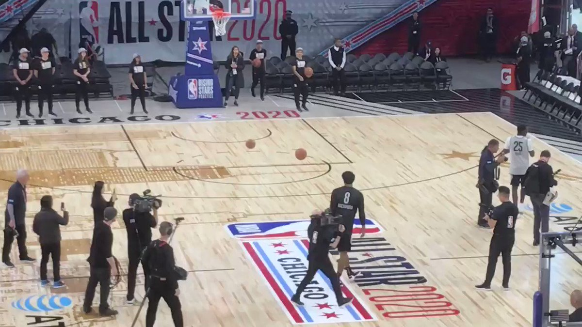 Rui Hachimura ends the Team World practice by casually swishing a halfcourt shot, then dapping up Zion Williamson on his way off the floor.