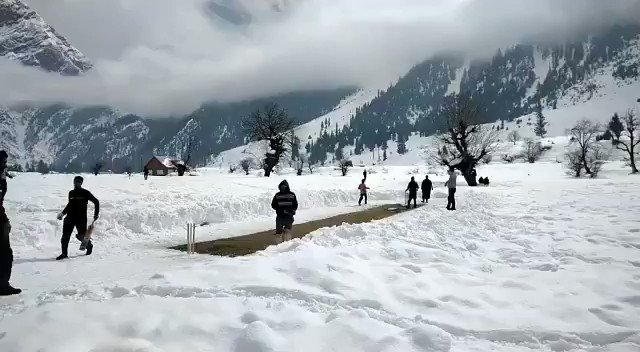 Anything for the game! This is a cricket match going on  in the snow draped Gurez valley in #Kashmir