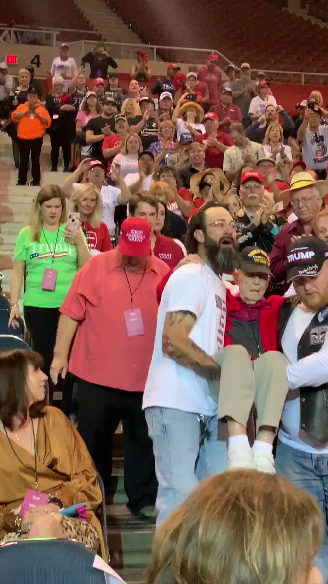 This happened at the @realDonaldTrump rally in Phoenix. Lots of teamwork here. These men carrying a World War II veteran to his seat. Got to admit I got a lump in my throat