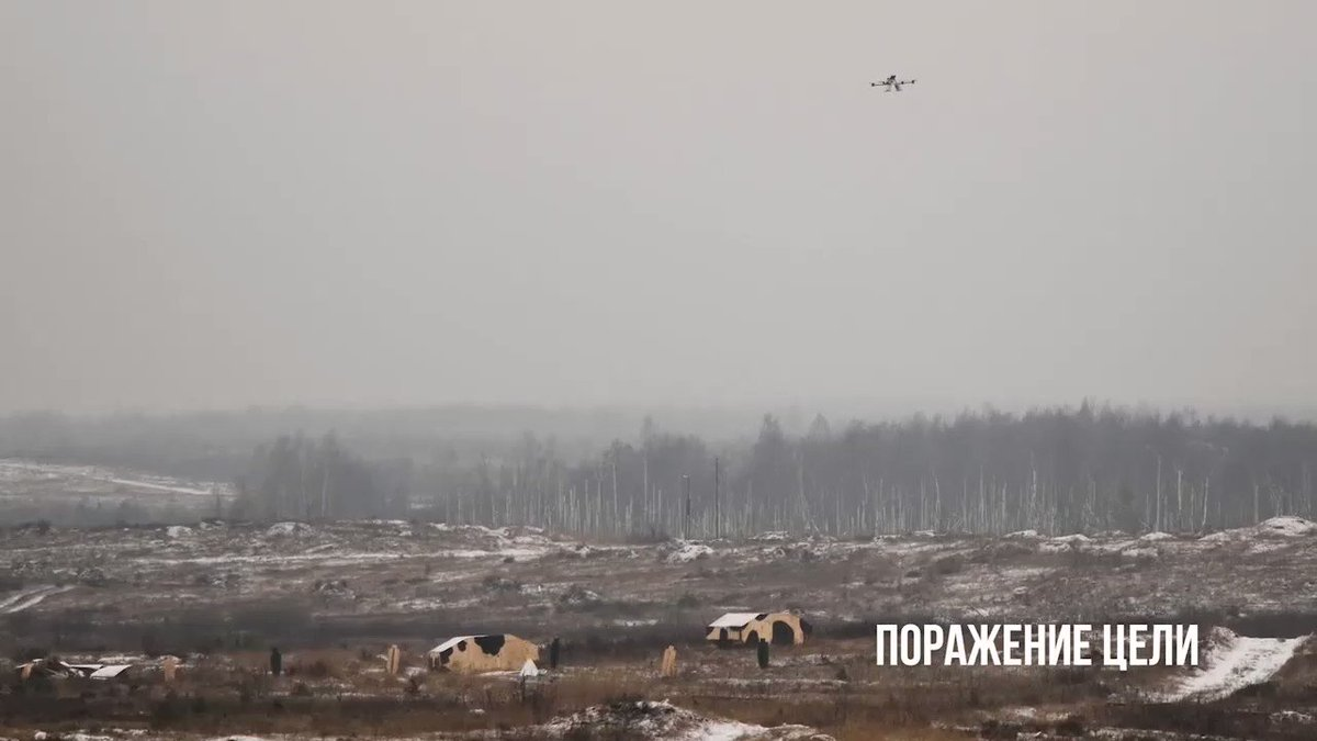 Video of the Belarusian Kvadro-1400 UAV equipped with two RPG-26 rocket launchers.