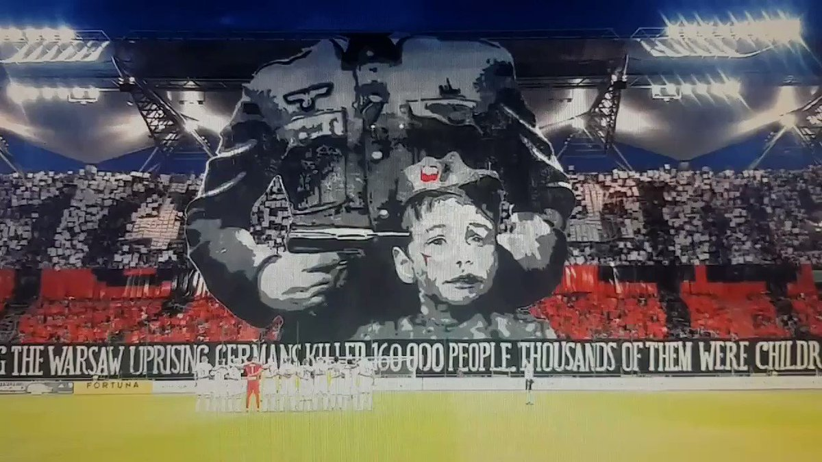 Legia Warsawa 🇵🇱 #legia A spectacular tifo in which a soldier appears pointing at a childs head. This act of Polish resistance originated on August 1, 1944 and claimed the lives of 160,000 people. Poland was especially punished during the tyrannical government of Adolf Hitler