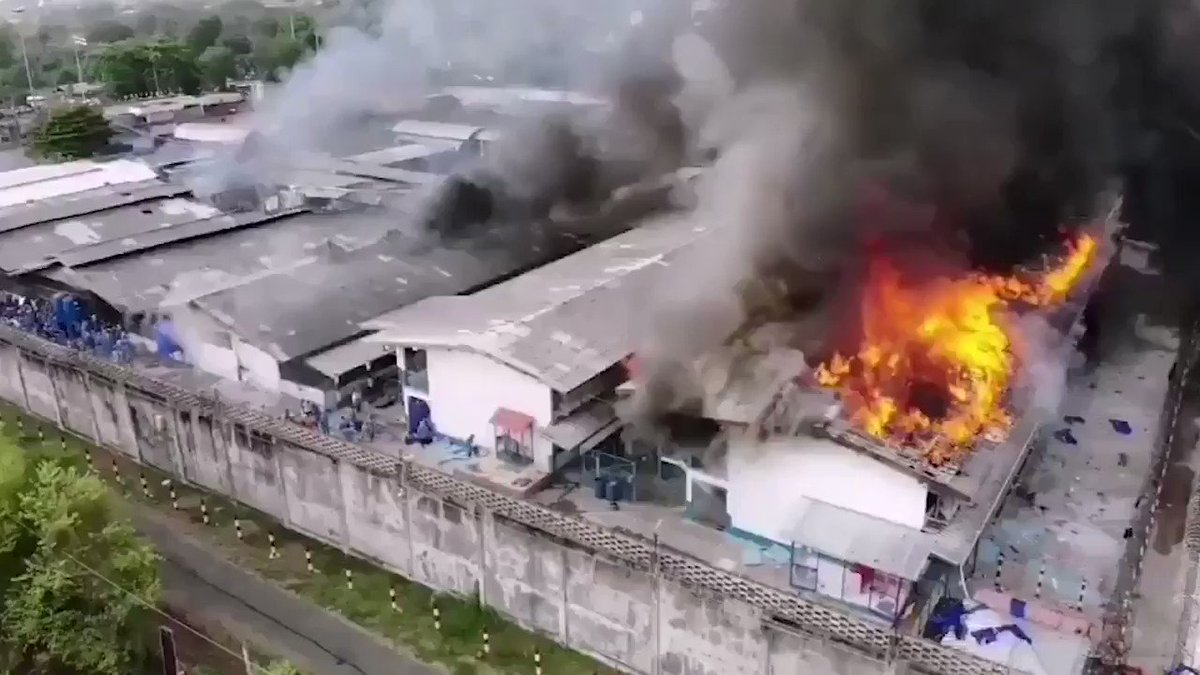 Drone footage of a prison riot in Thailand. Prisoners rose up over the prison's #coronavirus response, setting fire to parts of the compound as the guards were creating isolation cells for infected prisoners.  Several prisoners escaped. No deaths were reported. pic.twitter.com/ONfKYXYueJ