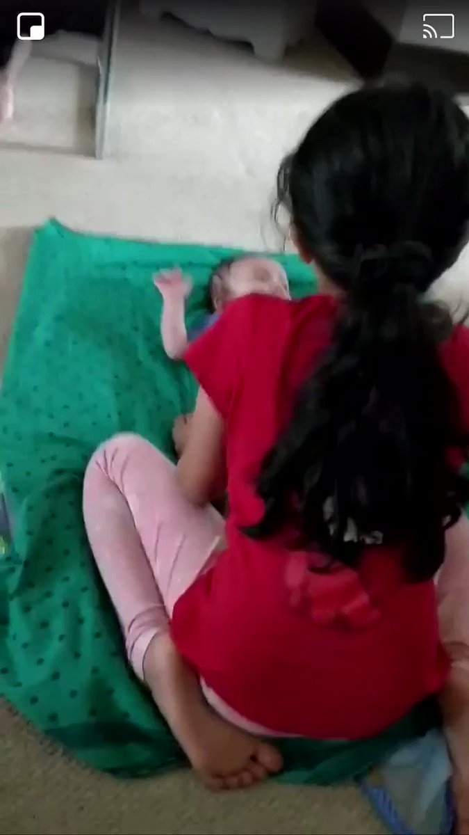 """JIX5A જીક્સા - Elder sister singing """"Shri Ramachandra Kripalu"""" to her baby brother some where in London.  Absolutely delightful to see this 🥰🙏🥰"""