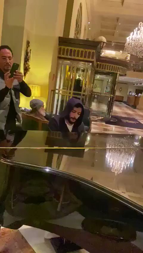 #WATCH: As they await their evacuation back to the kingdom, Saudis stuck in #Vienna play, sing their national anthem at the @GrandHotelWien   https://www.arabnews.com/Coronaviruspic.twitter.com/IE2Jd38cpy