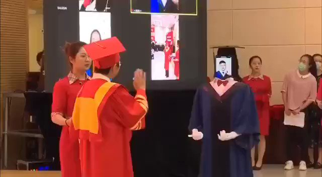 The new normal?!! A graduation ceremony at a university in Nanjing. Creepy as hell.