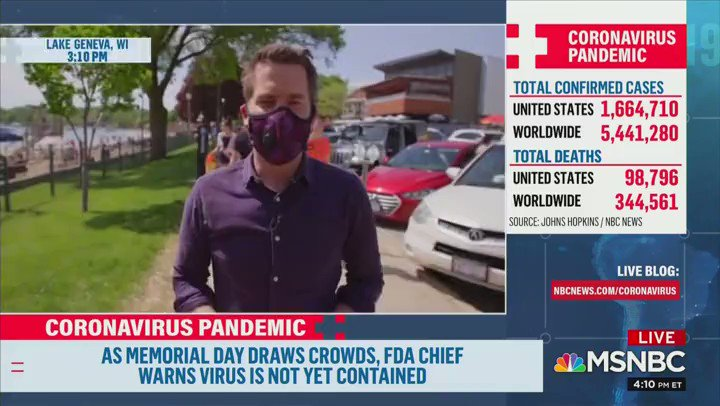 REPORTER: You can see here, nobodys wearing [masks]. GUY ON STREET: Including the Cameraman.