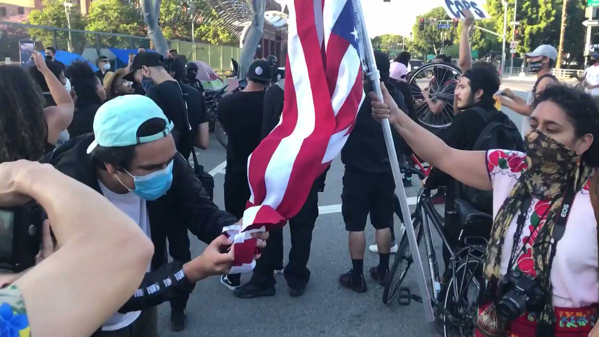Protesters in LA burn the US flag over the killing of George Floyd, an African American killed while a police officer kneeled on his throat for over 7 minutes as he repeatedly gasped I cant breathe, as Eric Garner had in 2014. Has the US reached breaking point?