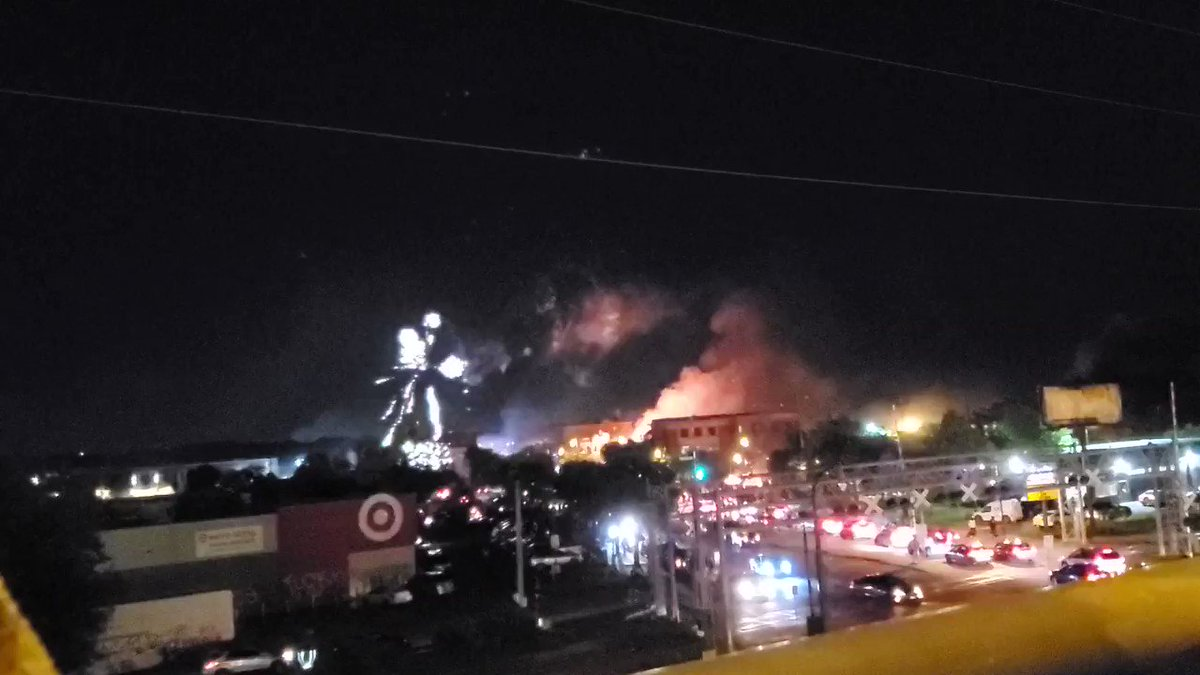 Fireworks shooting into the sky as the MPD Third Precinct burns. @kare11