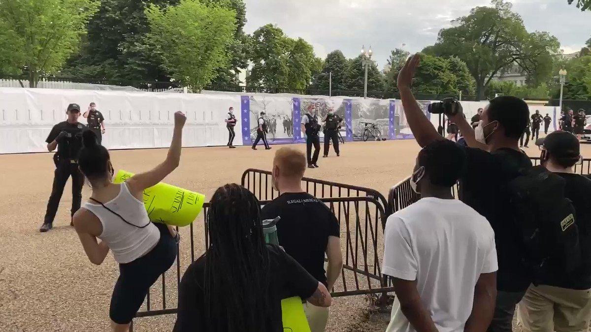 People have managed to toss over the temporary barricades, they're being pushed back by the Secret Service. More police arriving. Heating up fast outside the White House's north lawn.