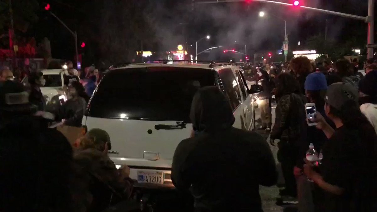 TENSE moment as this SUV tried to force its way through the crowd and got its tire slashed.