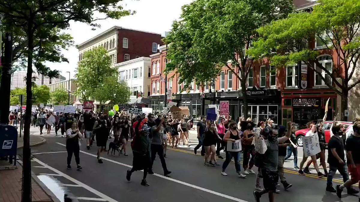 Marchers on Elm Street chant 'no justice, no peace.'