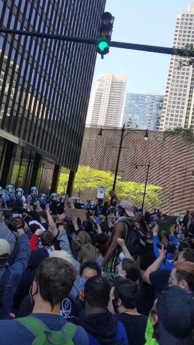 Crowd takes a knee in front of Trump Tower and riot police #chicagoprotest