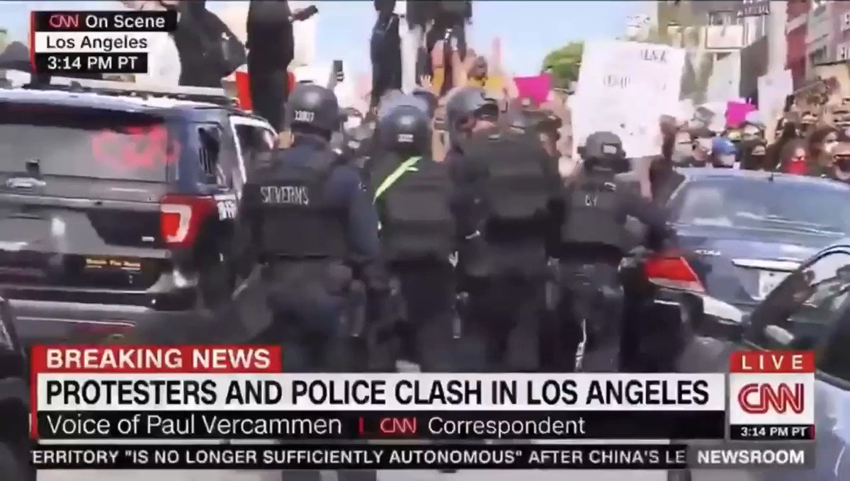 Police poked and beat protesters - several of them women - with batons. Protesters held up their arms as rubber bullets ricocheted. They refused to yield and held their ground until a burning police vehicle cleared the area. Fairfax District