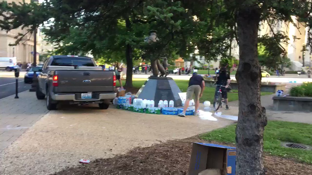 Louisville, KY — Police officers destroy and loot the water and medical supplies of peaceful protesters.