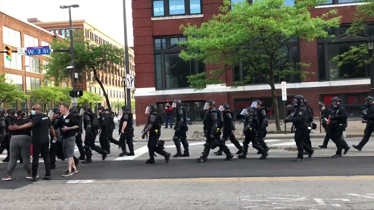 Police in full battle rattle are moving down W. 3rd.