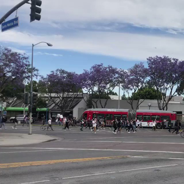 Image for the Tweet beginning: Protesters passing La Cienega on