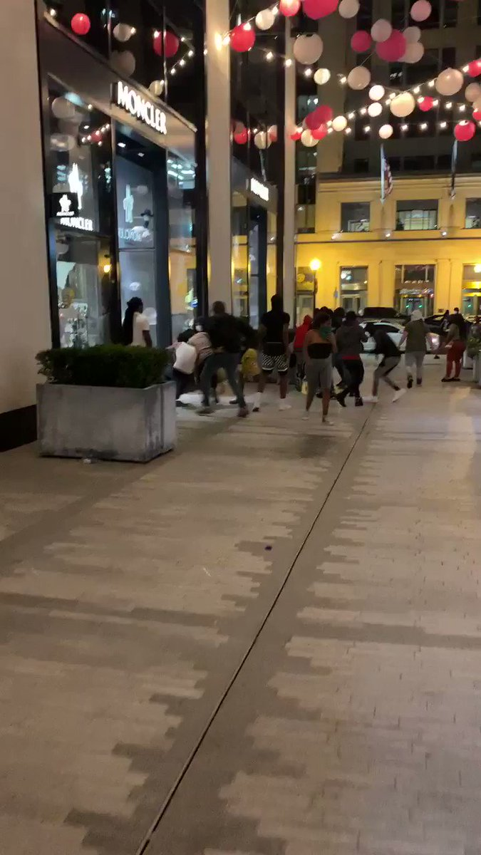 Looting at Moncler store front in NW.