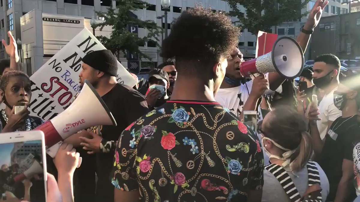 .@DevanteRHill is confronted by the people who oppose him and the protest momentarily stops.