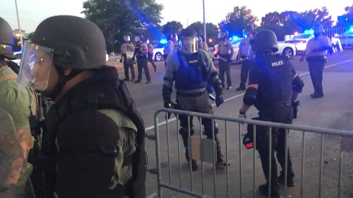 Police setting up barricades.