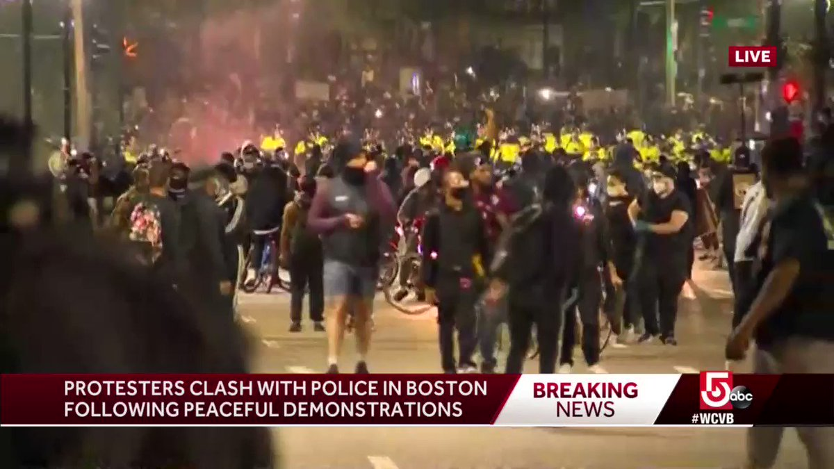 Clash between protesters and Boston Police on Tremont Street near #BostonCommon; video shows canisters with spray being thrown. #BostonProtests