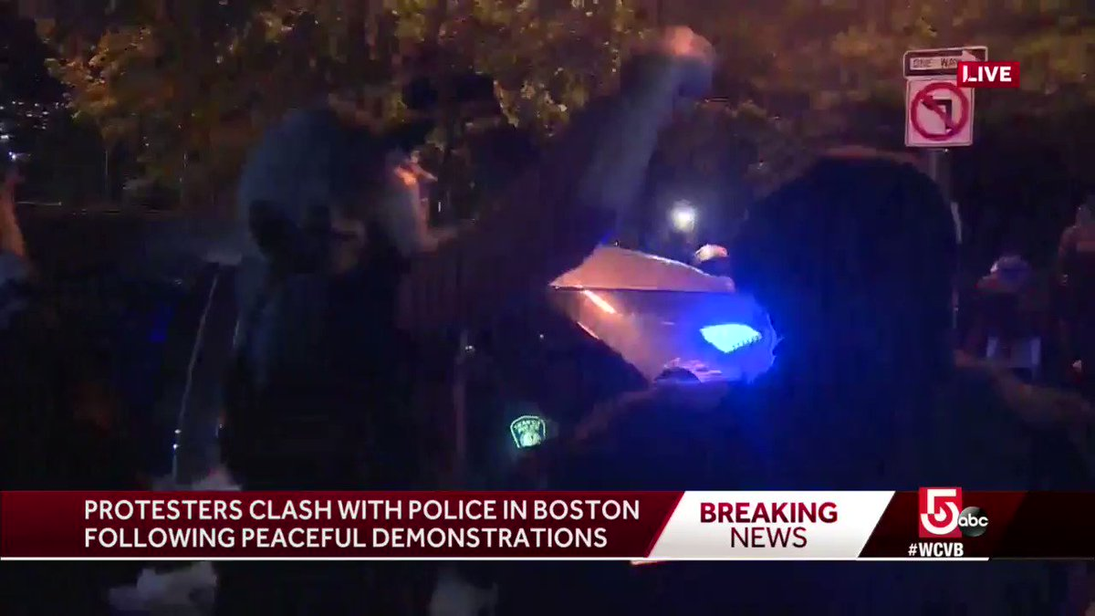 #BREAKING: Protesters jump on top of #MBTA Transit Police cruiser at the corner of Beacon and Charles St; @ToddKazakiewich reports projectiles are being thrown. #BostonProtests
