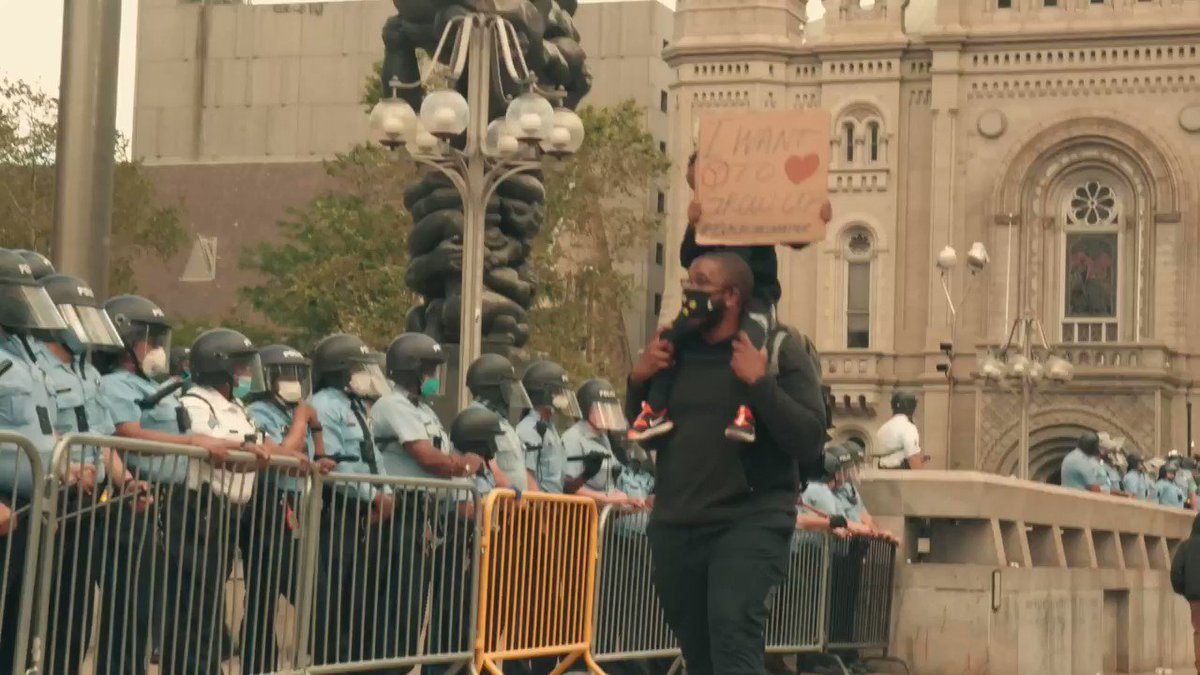 This was a moment I captured today with a father speaking on the dreams for his 4-year old son in front of a row of Philly cops protecting the monument to racism that is the Rizzo Statue. #blacklivesmatter #iwanttogrowup