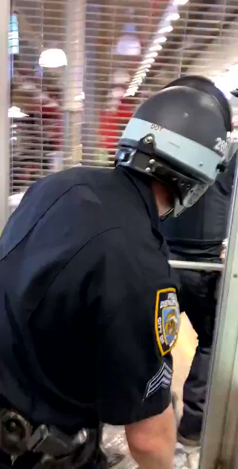 Video shows police officers beating looters in New York City last night. Rioters are screaming 'police brutality'.