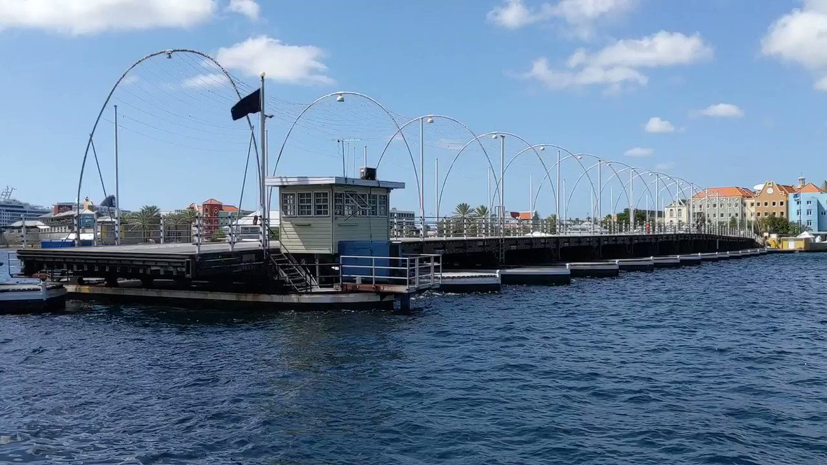 It's June 1st and since I'm tweeting about a Panama Canal cruise I took in early 2019, I have a great video to share from the port of #Willemstad, #Curaçao .  This is the famous Queen Emma floating #bridge that swings open up to 30 times a day to let boats and ships through! pic.twitter.com/59HnwT9eqL