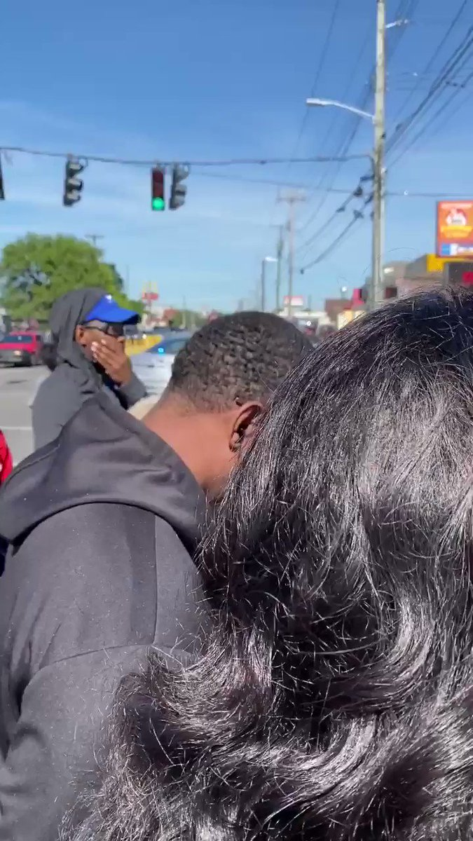 David McAtee was shot and killed by LMPD officers and the National Guard this morning. Family and witnesses say law enforcement should have never been there. McAtee was serving food at his bbq spot at the time. His family is praying in front of #lmpd officers #louisville