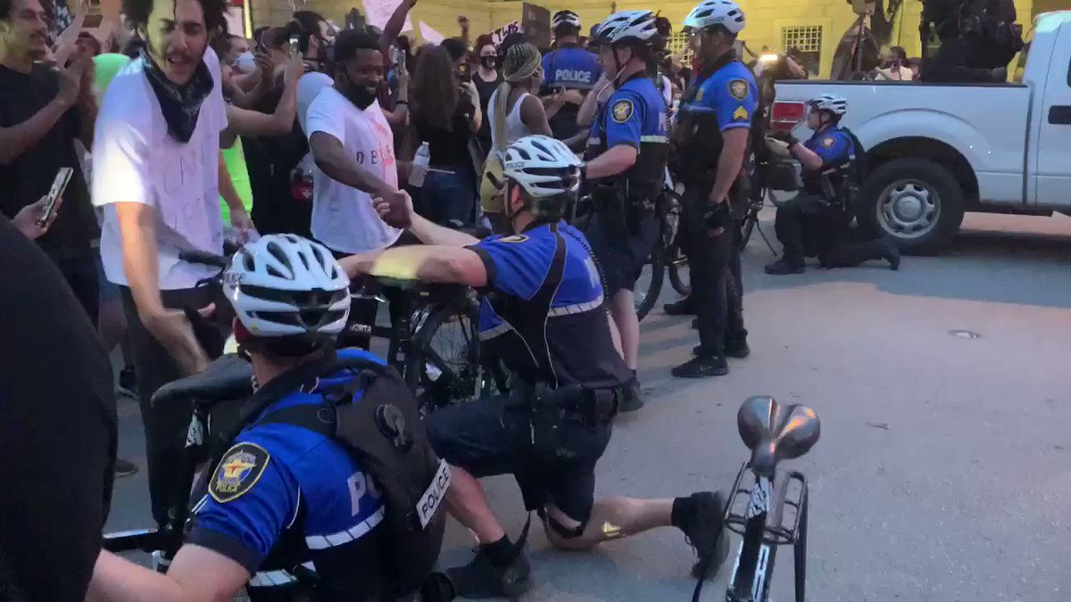 Protesters just told police on bullhorn if officers took a knee they would go home. Officers took a knee. Protesters came up to cops and shook their hands, hugged them. Remarkable.