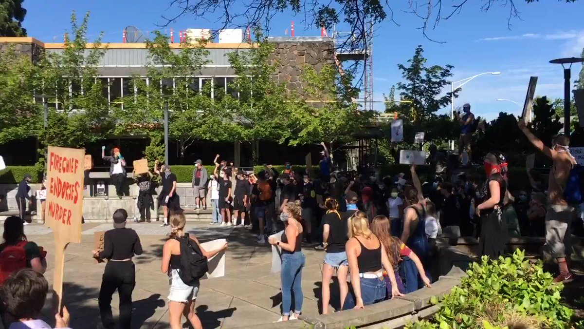 """A crowd of about 200 at the Lane County Courthouse here in Eugene shouting """"I can't breathe"""""""