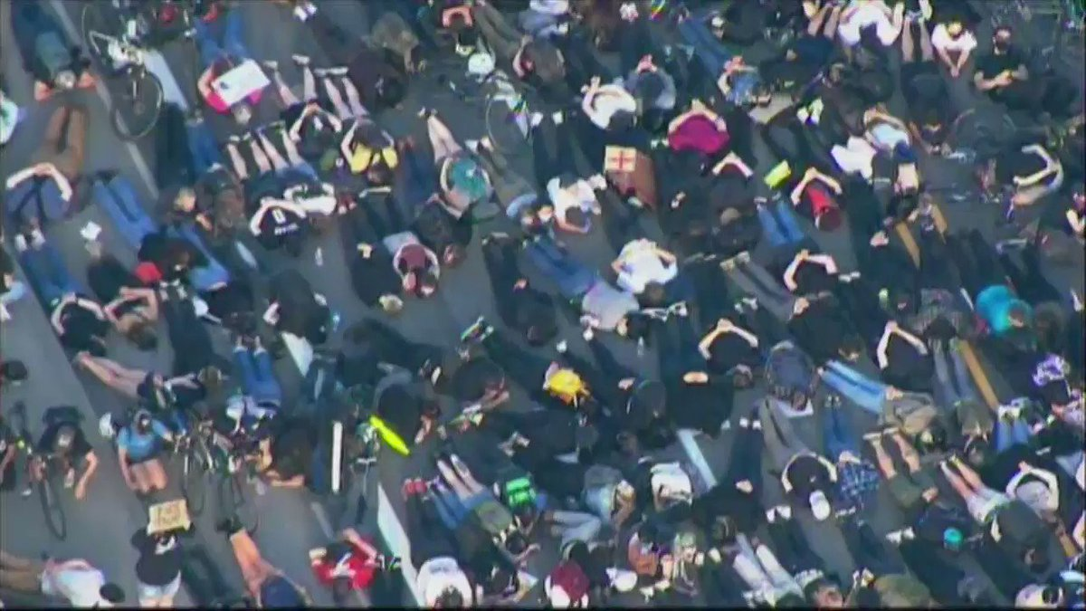 Image for the Tweet beginning: thousands of protesters are laying