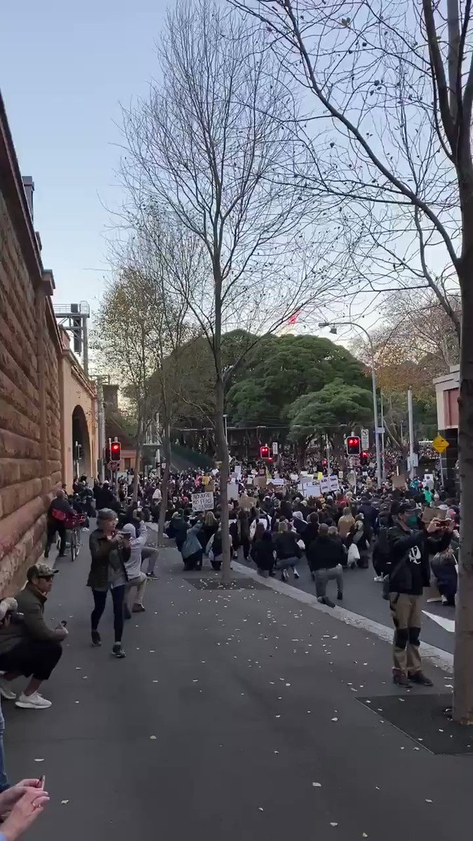 The march paused for a moment, kneeling in the street in remembrance of those deaths in custody. This is Castlereagh St, just down from Central Station. The crowd is now chanting George Floyd's name https://t.co/usgbv1C41A