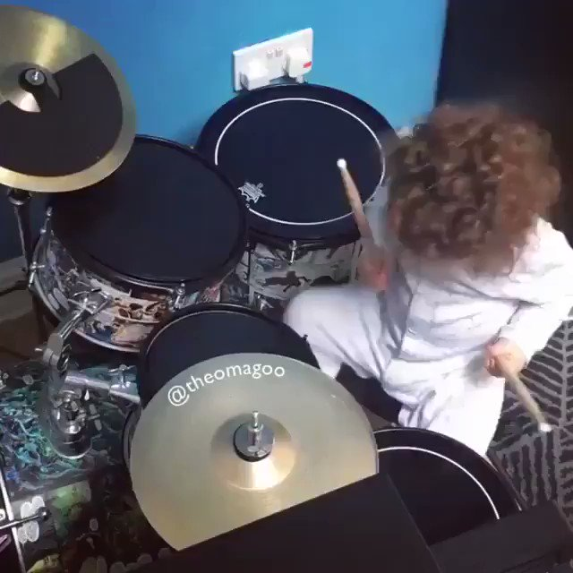 This baby playing the drums with daddy is the best thing you'll see today.   Come for the drums - stay for the boo-boo kiss...