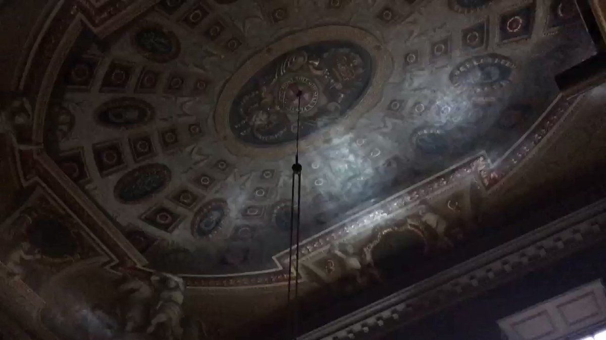 Hum, I wondered, why was the chandelier missing from the ceiling of the Queen's Stairs at @HRP_palaces Hampton Court? The answer was that conservators Laurie & Shelley had lowered it to clean it & it was such a cool thing to see.