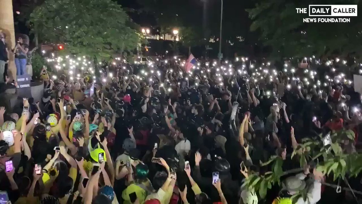 """Portland crowd singing """"hands up, please don't shoot me"""" with their phone lights on. https://t.co/dqOgRJrM3Z"""