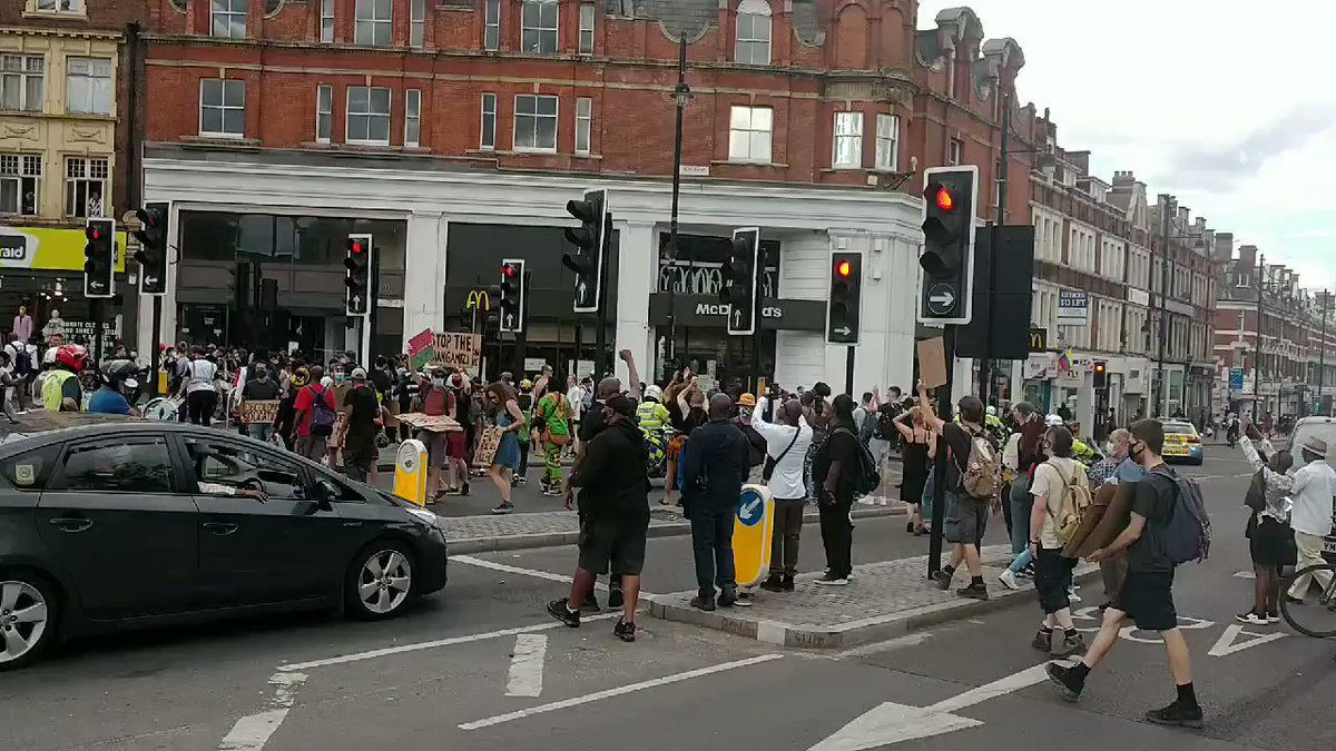 Brixton road, Coldharbour Lane & Acre Lane in Brixton town centre have been closed for Reparations Rebellion We demand the UK government establish a Commission on Truth & Reparatory Justice and commit to holistic reparations, including planetary repair. #ExtinctionRebellion