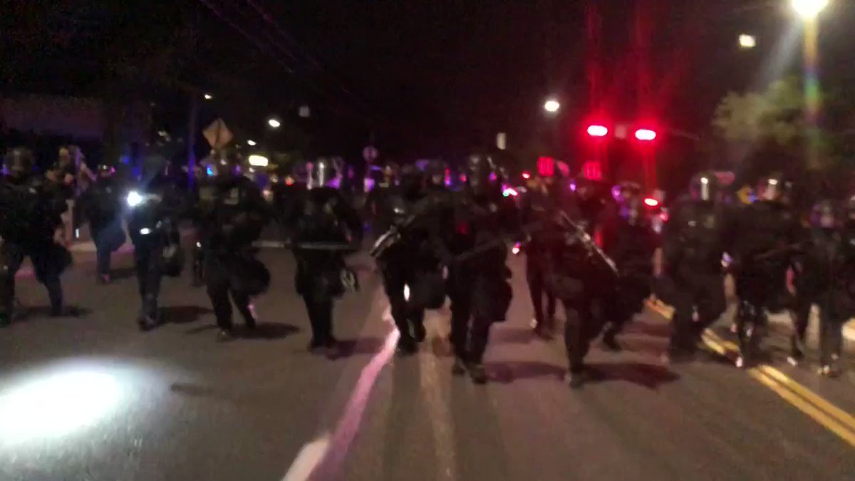 Portland Police bull rush #antifa rioters on the street, knocking some of them to the ground. #PortlandRiots