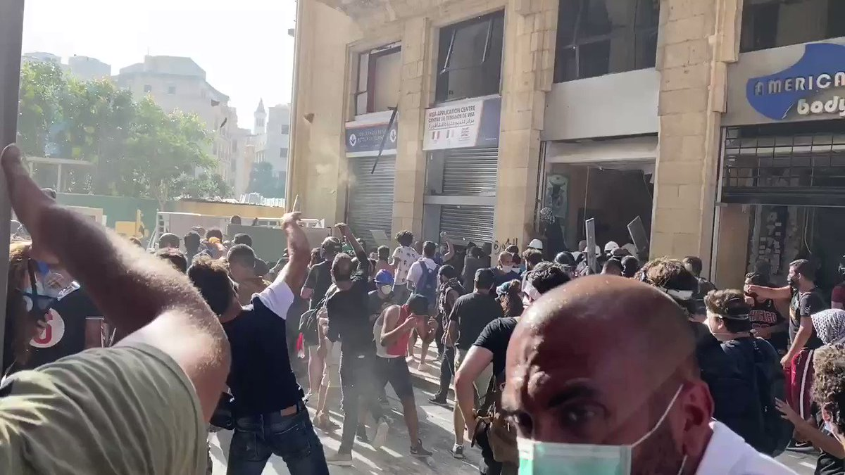 Hundreds trying to reach the parliament building from different roads throwing stones and rocks. Riot police firing lots of tear gas. #beirut