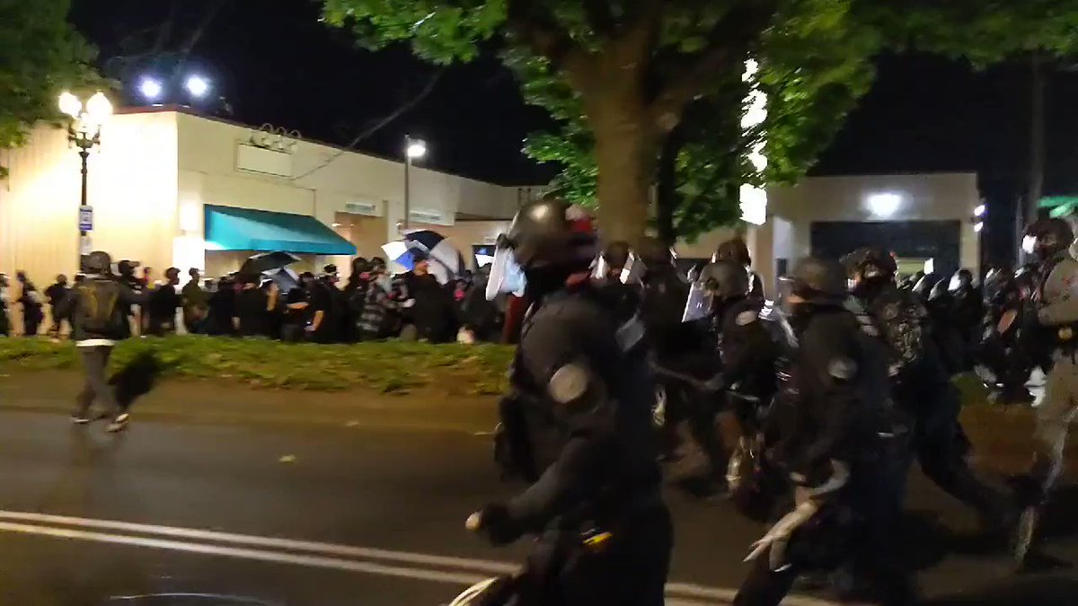 Image for the Tweet beginning: Police in Portland rush at