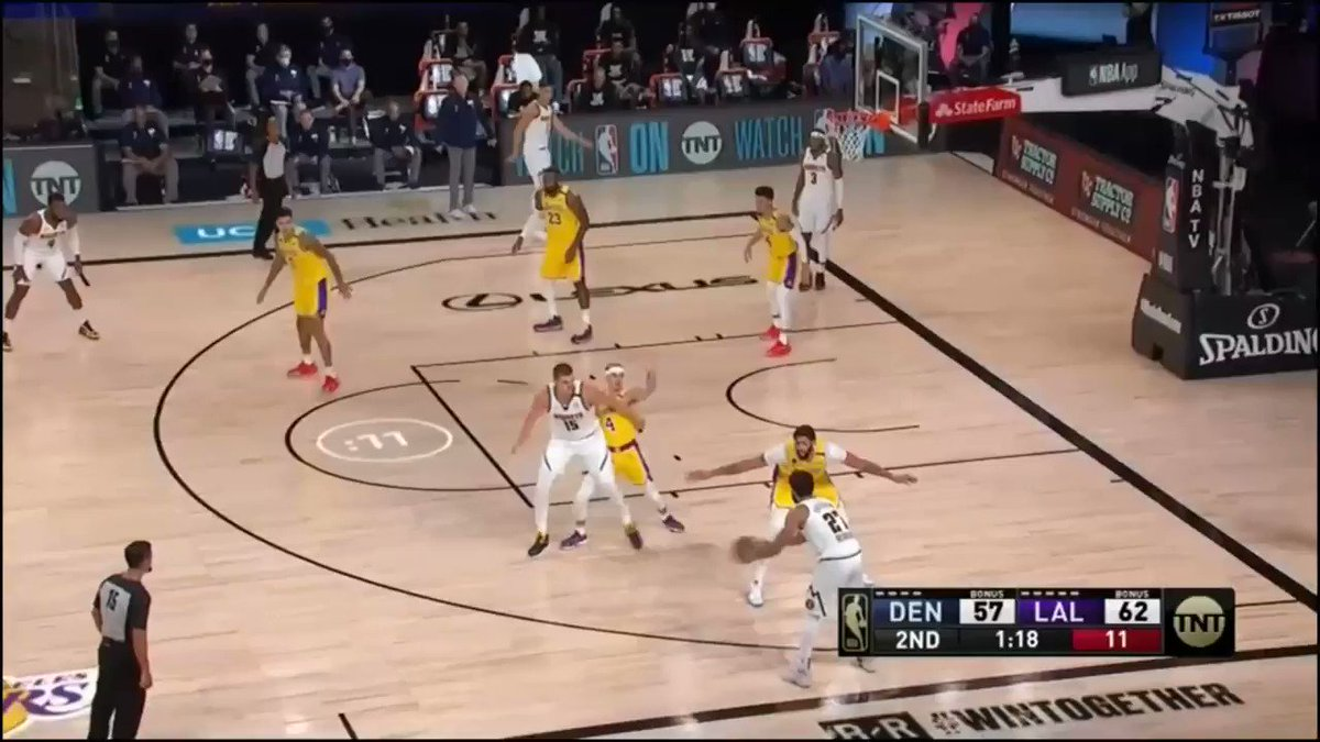Nikola Jokic drives in from the high post, gives it to Torrey Craig whose first layup attempt doesn't go but he gets the offensive rebound and putback. #Nuggets #MileHighBasketball https://t.co/5rd2507ERw