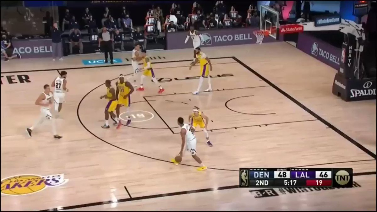 A mirror image of the same play run later in the game with Jamal Murray, but this time it's P.J. Dozier who drives in and draws the double out of the PnR, then kicks it out to Nikola Jokic for the open 3-pointer. #Nuggets #MileHighBasketball https://t.co/jW7kmVJN12