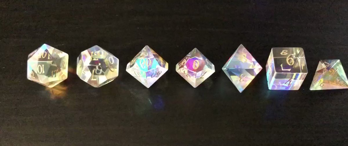 My new dichroic dice from @urwizards came in today! MY GOODNESS THEY ARE PRETTY.
