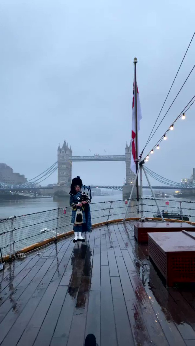 This morning, as the sun rose on the 75th anniversary of Victory Over Japan Day, a lone military piper played 'When the Battle's O'er' on the deck of @I_W_M HMS Belfast, London. #VJDay75 #Neverforgotten