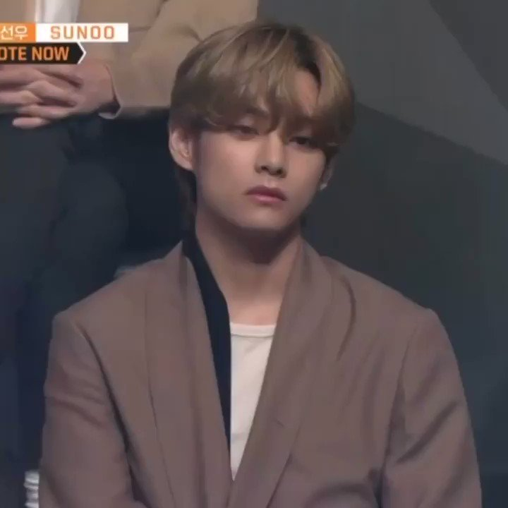 Taehyung is carefully observing the performance while looking like the most intimidating man in there 😳 #ILANDTheFinale