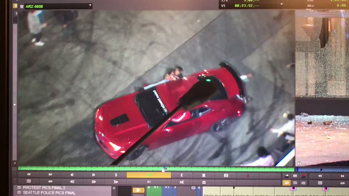 Graphic video shows spectator getting hit by a car doing illegal doughnuts near the Seattle Space Needle.