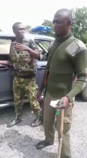 """""""@Omezuo1: Part 1....In this video, Some Police officers were caught collecting bribe from motorists. The military saw them and came for the motorists rescue. 😂🤣 This is how to deal with corrupt Police Officers. #EndSARS #ReformTheNigerianPolice #EndSWAT #EndPoliceBrutality"""