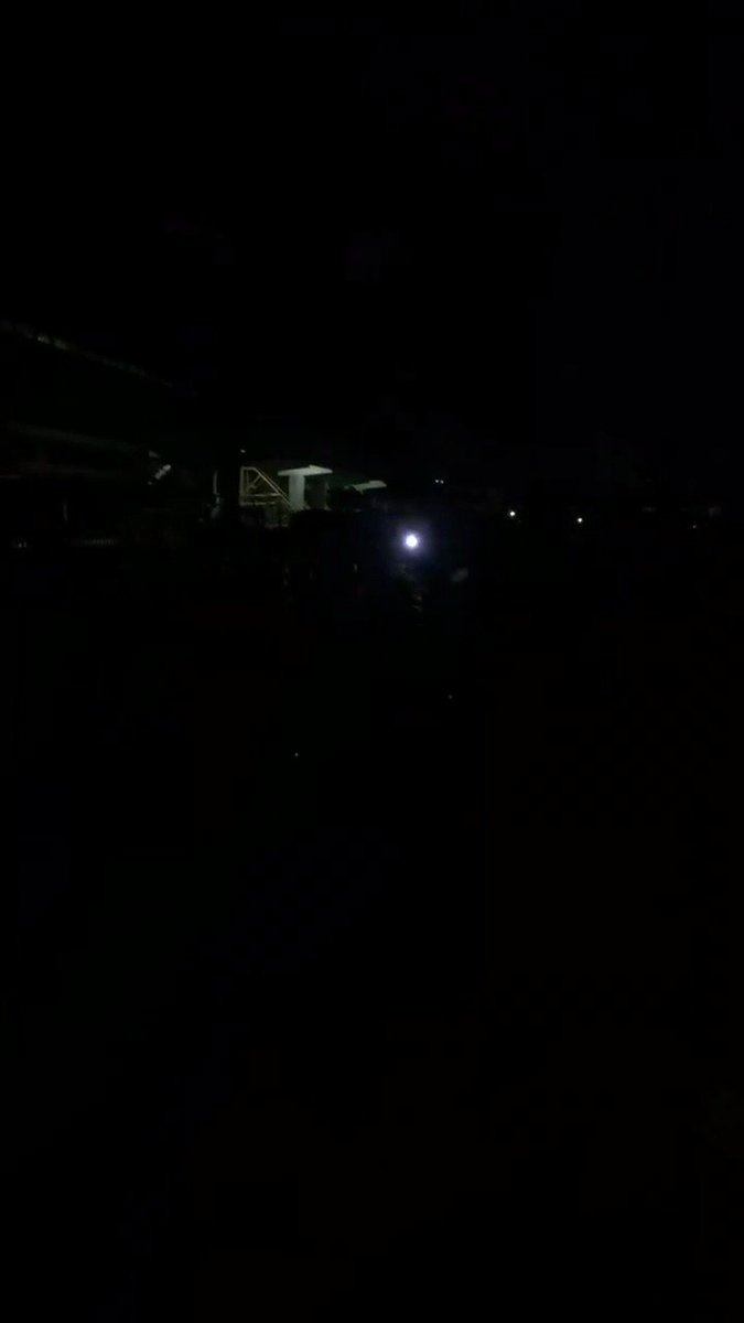 #Nigeria: brave survivors of the Lekki Toll massacre sing the national anthem in pitch-black darkness as sounds of gunfire from violent security forces ring out. #EndSARS #BuhariResignNow #EndBadGoveranceInNigeria