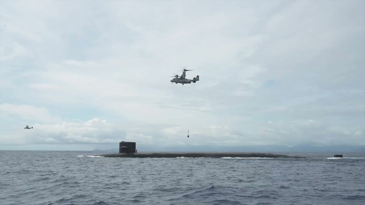 Watch as an MV-22B Osprey, attached to Marine Medium Tiltrotor Squadron (VMM) 363, delivers a payload to the Ohio-class ballistic-missile submarine USS Henry M. Jackson (SSBN 730), Oct. 21. #Submarine #Osprey #Marines @INDOPACOM @USNavy @US_Stratcom @USPacificFleet